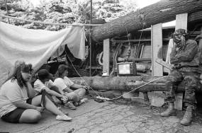 Mohawks watching Oka crisis news on barricades. 28 August 1990. Kanesetake, Quebec.