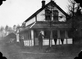 Hungarian settler, Lorincz Szigety, and family in front of their new home.