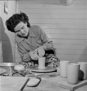 Potter, Mollie Carter, at work, 17 Dec. 1949.