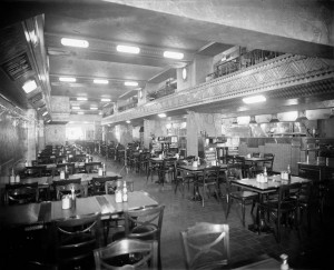Black and white photograph of a restaurant.